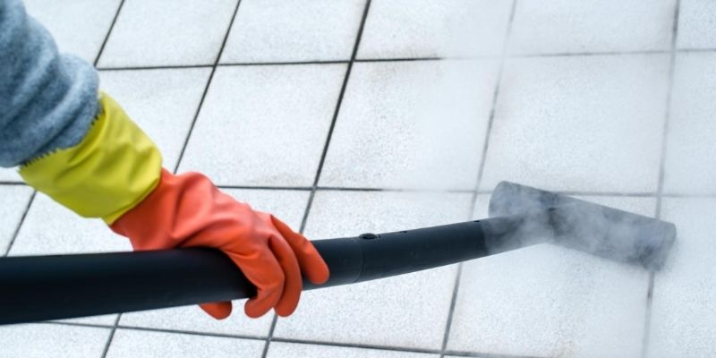 Removing mold from tiles with steam mop