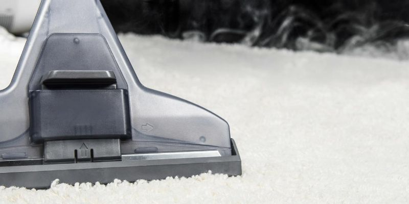 Cleaning a white carpet with steam cleaner