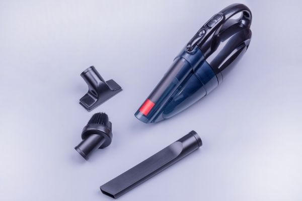 Portable carpet cleaner with accessories