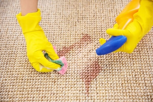 Cleaning carpet with chemicals