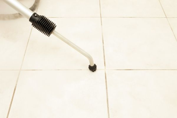 Cleaning grout on tiles with steam cleaner