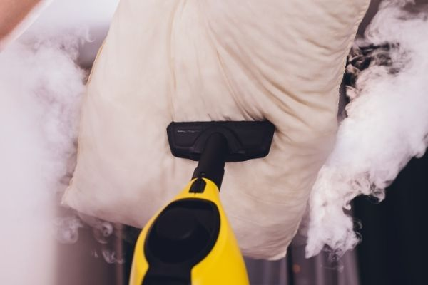 Using a steam cleaner to clean a pillow