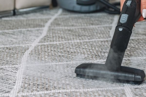 Black and grey steam cleaner used for carpets