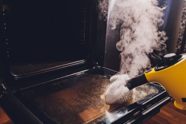 Getting grease off an oven using a steam cleaner