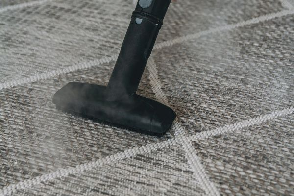 Cleaning carpet using steam